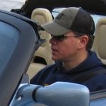 see full image of Matt Damon in a Tesla Roadster